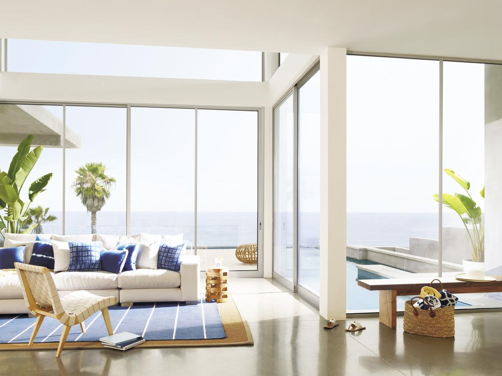 Hunter Douglas Nantucket™ Window Shadings in a costal view living room