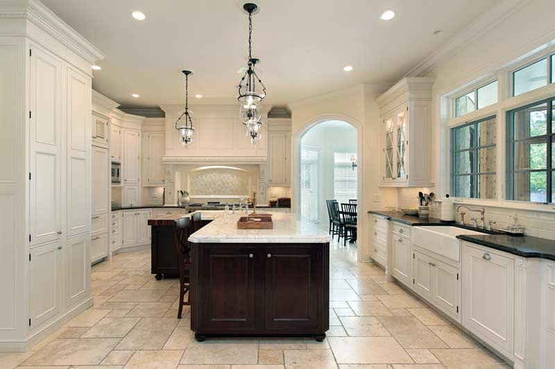carrara marble countertop on island designed kitchen