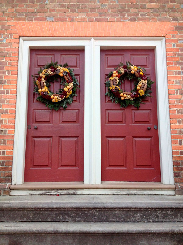Fall Wreaths on Red Door during Holiday Season