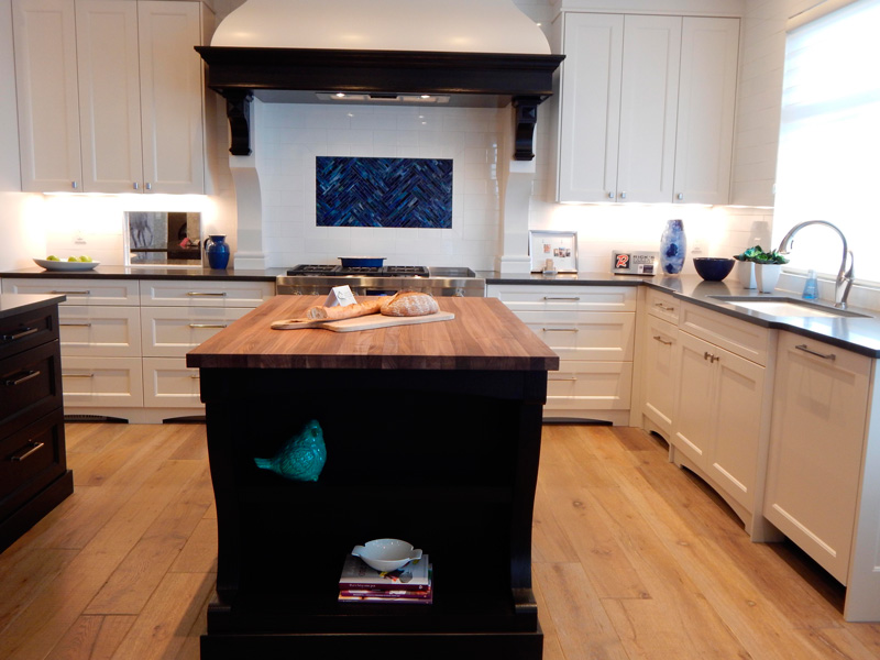 kitchen island with butcherblock counter and black paint
