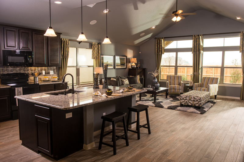 model home kitchen with wood floors