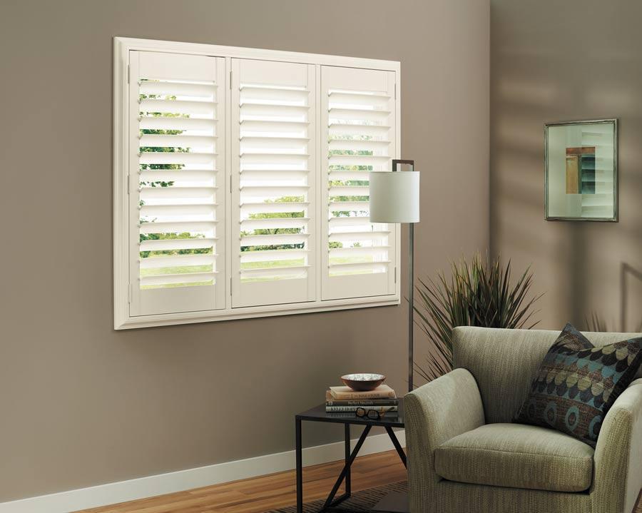 Hunter Douglas Heritance® hardwood shutters in sitting room